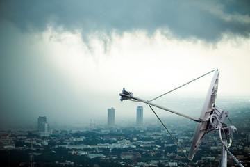 Antenna communication satellite dish with storm background
