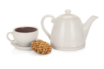 Cup of tea with teapot and a coockie on white