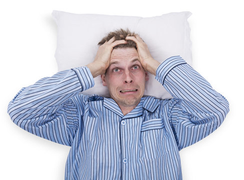 Stressed man in pajama in bed