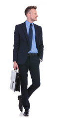 business man with suitcase and hand in pocket