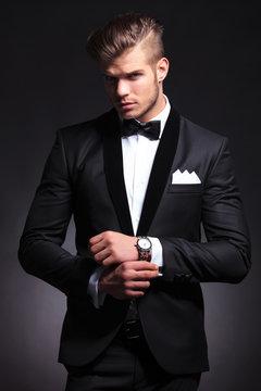 business man fixing cufflinks