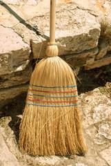 Old straw broom