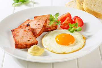 Pan-fried Leberkase with sunny side up fried egg