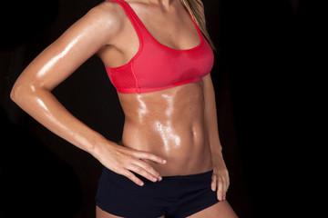 woman body sweat red sports bra on black