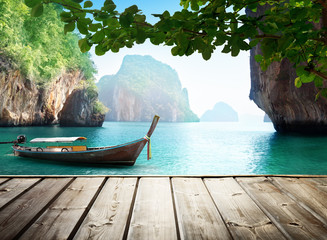 Fotomurales - Adaman sea and wooden boat in Thailand