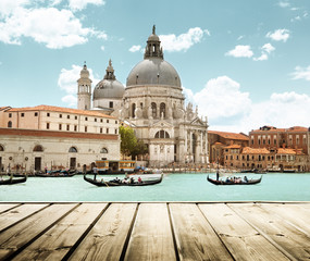 Foto op Plexiglas Venetie Basilica Santa Maria della Salute, Venice, Italy and wooden surf