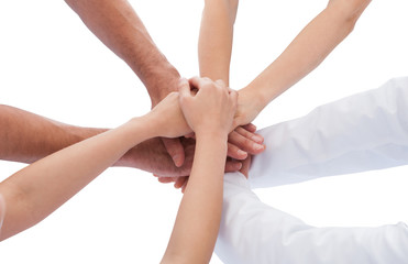Group Of Doctors Stacking Hands Together