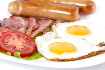 Breakfast with fried eggs with bacon and vegetables