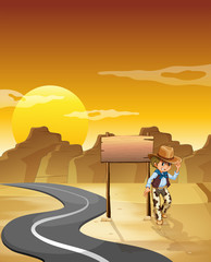 A cowboy at the desert with an empty signage