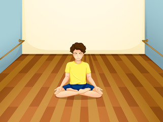 A man with a yellow shirt performing yoga inside a room