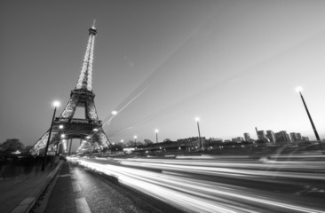 PARIS - DEC 1: Cars speed up in Pont D'Iena with Eiffel Tower in