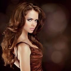 Hair. Beautiful Sexy Brunette Woman. Healthy Long Brown Hair. Be