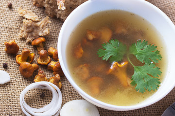 Cup of soup with chanterelles