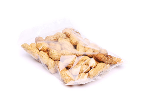 plastic bag of peanuts on the white background