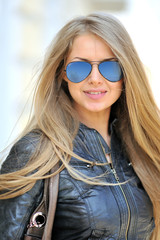 Beautiful woman face wearing sunglasses