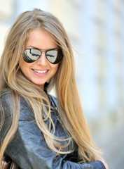 Beautiful woman face wearing sunglasses - closeup