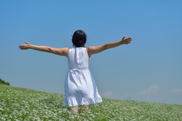 Young happy woman in green field
