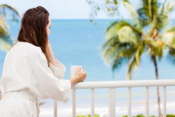 Woman on a tropical balcony