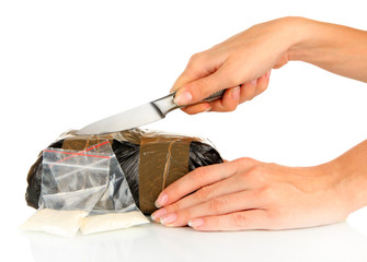 Packages of narcotics in hand isolated on white
