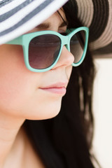 Young brunette in turqoise sunglasses