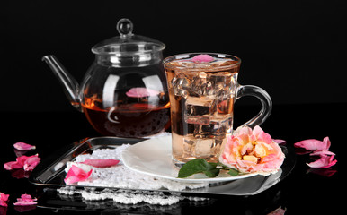 Kettle glass cup of ice tea from tea rose