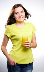 young beautiful girl in a yellow shirt holding a orange juice