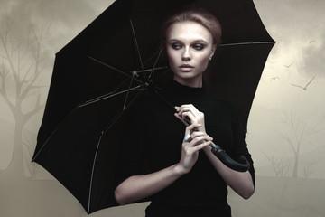 Beautiful girl portrait with umbrella