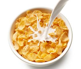 Fototapete - corn flakes with milk