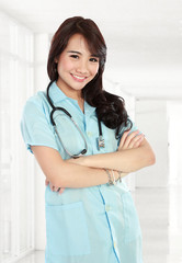 young nurse smiling with arm crossed