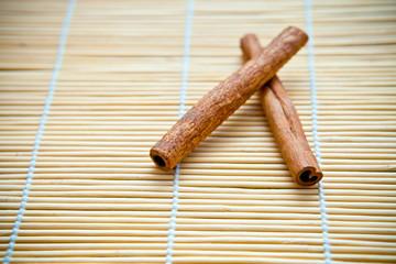 Vanilla sticks on a wooden mat
