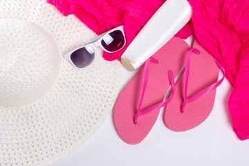 flip flops, hat, sunglasses over white