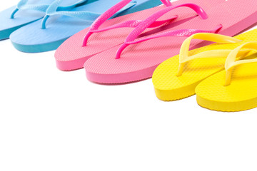 colorful summer flip flop shoes over white