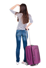 Back view of brunette woman with suitcase looking up