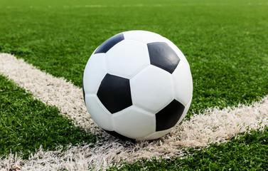 football on green grass field conner