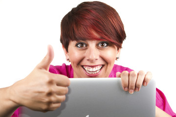 Woman using laptop and doing thumbs up