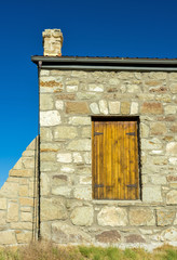 Sandstone building and antique wooden door