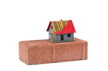 red brick and small house model building concept isolated