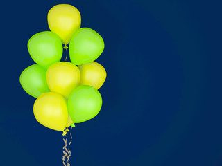 Luminescent balloons on blue background.