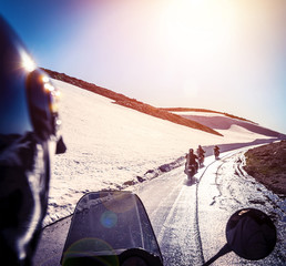 Fototapete - Group of bikers on snowy road