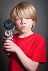Boy with toy space gun