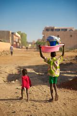 Kids walking in the street of Mopti