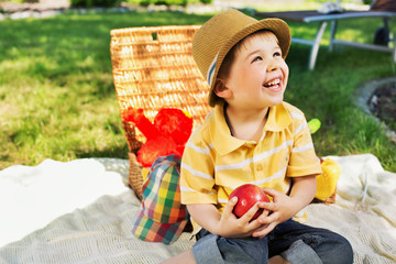 Smiling chlid holding juicy apple