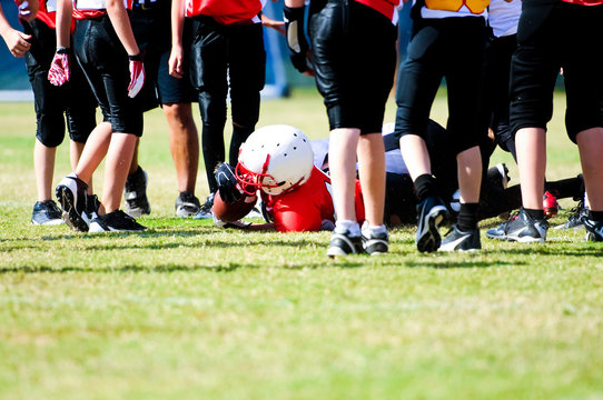 Youth football boy after tackle