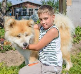 a boy with a dog