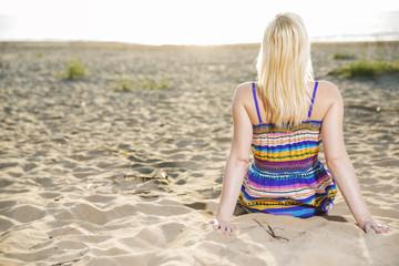 Woman in dress take sunbath at day