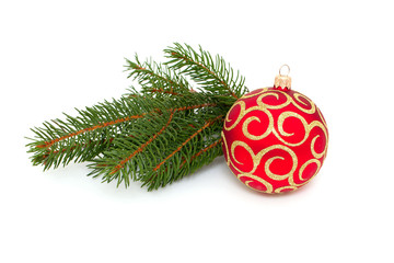 Christmas ball and twig of pine isolated on white background
