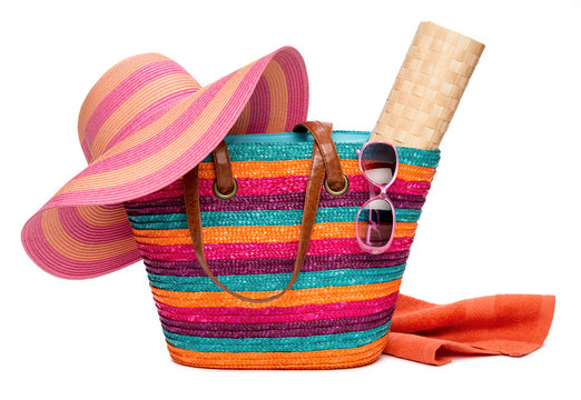 Colorful striped beach bag with a hat sun mat towel and sunglass