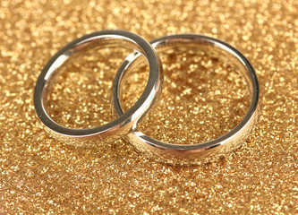 Wedding rings on bright background