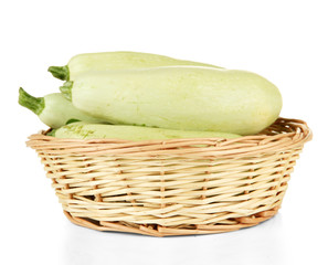 Fresh marrows in wicker basket, isolated on white