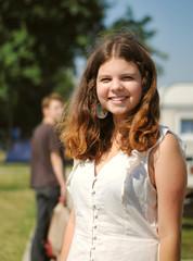 Cheerful smiling teenage girl outdoor portrait